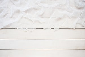 White wooden table with cheesecloth