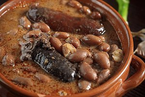 Spanish fabada on rustic background
