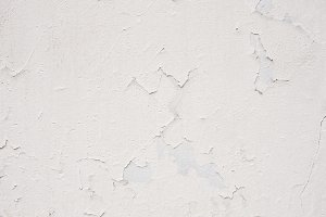 Old white wall with a shabby paint