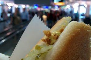 traveler eat a hot dog