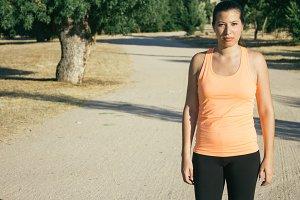 Runner woman in a dirt road
