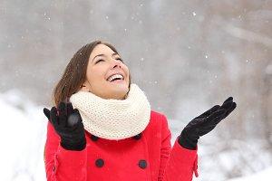 Candid happy girl enjoying snow in winter.jpg