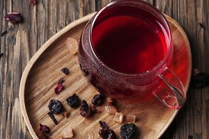 Red hot tea on the wooden table