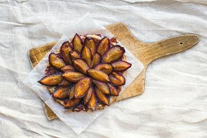 Plum pie on a wooden board