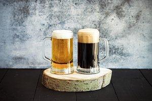 Light and dark beer in mugs