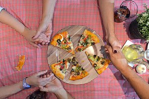 aerial view of family eating pizza