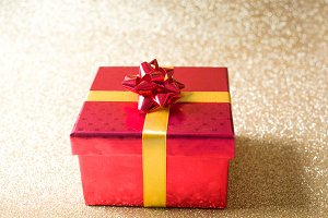 Red gift box with golden glitter