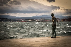 Statue of child by the sea #01