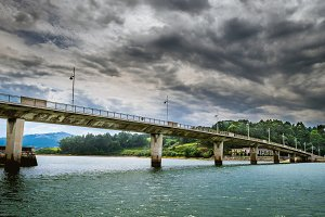 Bridge under a cloudy sky