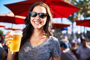 woman drinking beer on sunny day