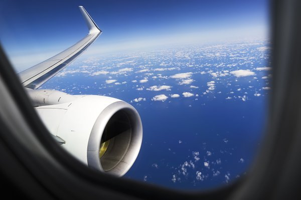 Airplane Window Blue Sky And Clouds High Quality Transportation