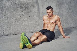 Muscular man relaxing after workout