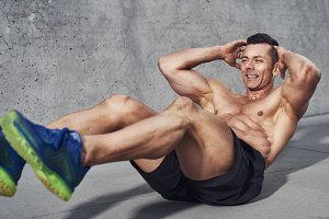 Male fitness athlete doing sit ups