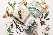 Fabric wrapped gifts and wooden Chri