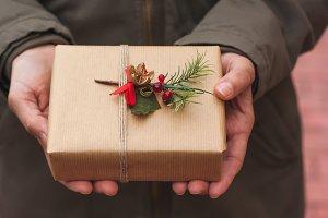 Woman holding a Christmas gift