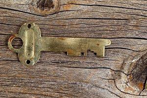 Vintage key on rustic wood
