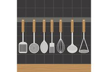Kitchen utensils weighs on a wall