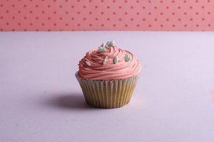Pink cupcake With whipped cream, and