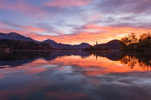 Dark and vivid sunrise at lake Bled