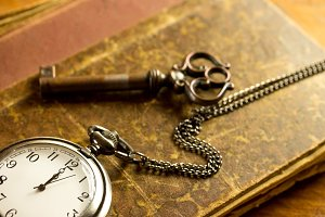 pocket watch showing twelve o'clock