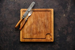 Cutting board and fork and knife set