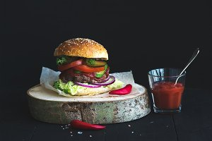Homemade burger on wooden board