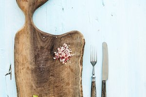 Chopping board, knife and fork