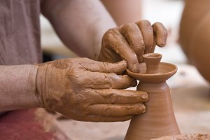 Potter working with clay