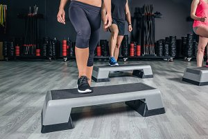People legs over steppers training
