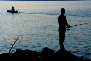 Fisherman and boat
