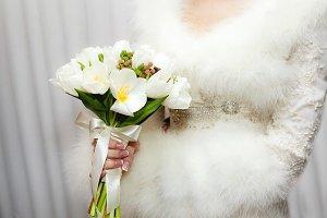 White tulip bouquet in bride's hands