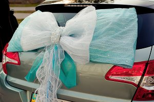 Romantic wedding decoration on car