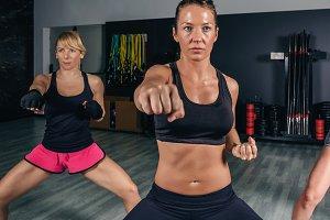 Women in a boxing class training