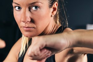 Woman training hard boxing in gym