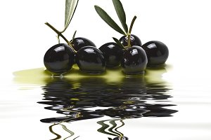 Black olives over white background