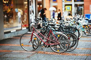 Parked Bicycles On Sidewalk.