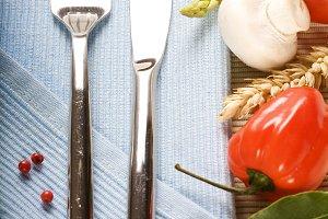 fork, knife and fresh vegetables