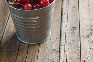 Bucket with cherries