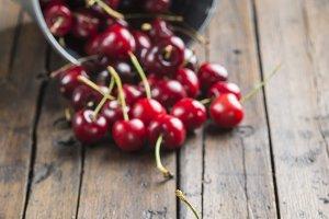 Bucket with cherries