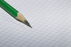 Green pencil and notebook