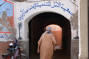 Old man walking in arabian medina