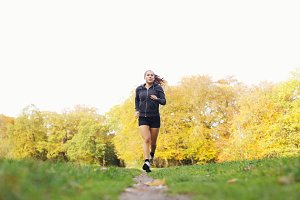 Fit and helathy young woman running