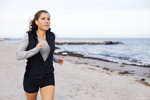 Fit and healthy woman jogging