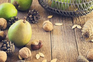 Autumn composition of fruits, nuts and spices - pears, walnuts  on a wooden background