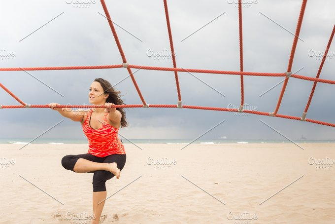 Woman streteching her leg.jpg - Sports
