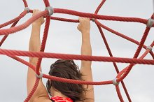 Woman Stretching her Back with some ropes.jpg
