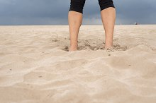 Feet of a Woman in the Sand.jpg
