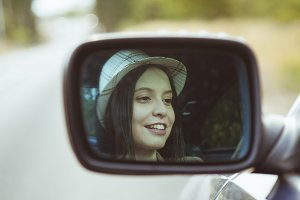 girl in the car in the mirror