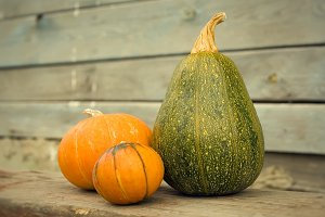 Pumpkins on a wooden background