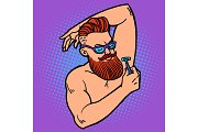 bearded hipster man shaves his